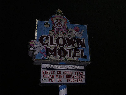 """A motel sign that reads, """"Clown Motel"""""""