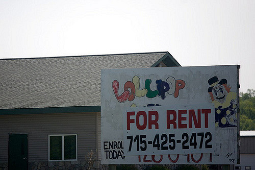 A photo of a closed daycare using a clown on its sign.