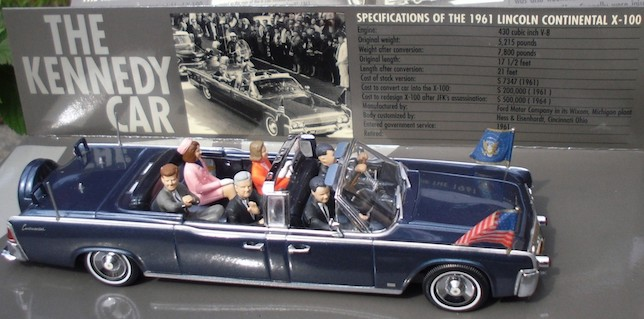 A photo of the replica X-100 with Kennedy and his party.