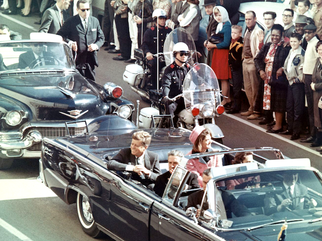 A photo of President Kennedy and his party in the X-100